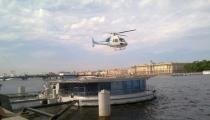 Berthing float with helicopter deck